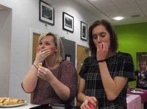 Diana and Kelly test the cakes!